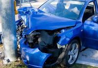 Blue crashed car