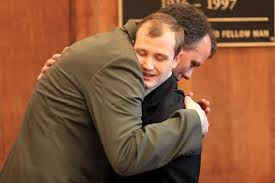 LAWYER HUGGING CLIENT