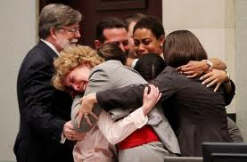 LAWYER HUGGING CLIENTS